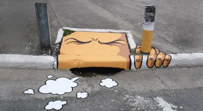 creative-interactive-street-art-sarjeta fumar