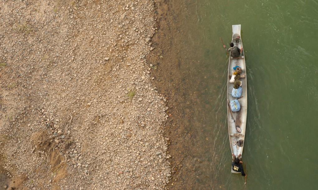 suca guerra Laos canoa mark watson